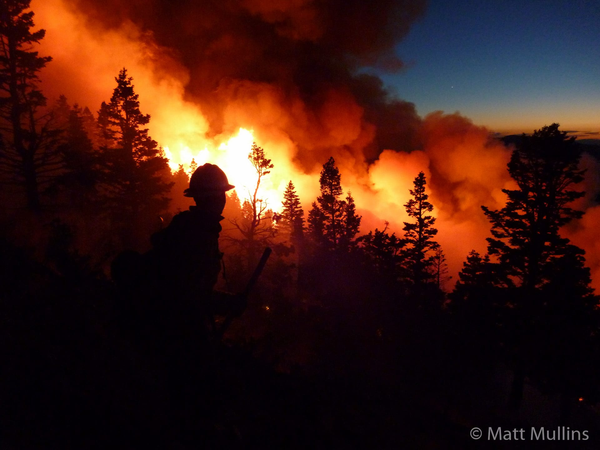 Fighting wildland fire at night.